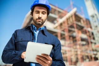 Construction-specialist-using-tablet